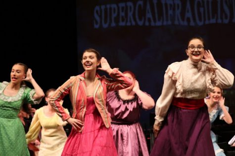 Izzy York, Jaylin Anders, and Lily Campbell, along with ensemble, perform Supercalifragilisticexpialidocious.