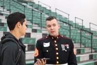 Senior editor Matthew White interviews Marine Corps Staff Sergeant Brian Lister before the veteran's assembly