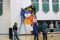 Norman North students put up a poster of all five branches in the military