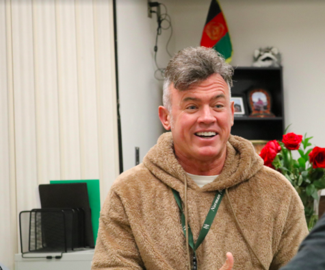 Mr. Weber laughs while remembering his military career