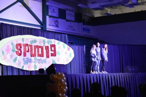 The three SPUD chairs announce at the end of the assembly that SPUD week has begun