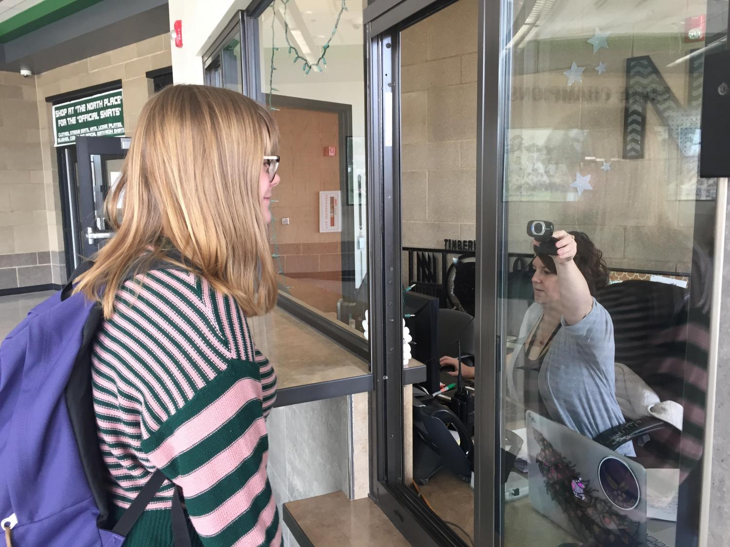 Zoe Kelley getting an ID at the commons office.