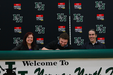 Blake Yohn celebrates with his parents as he continues his career in college.