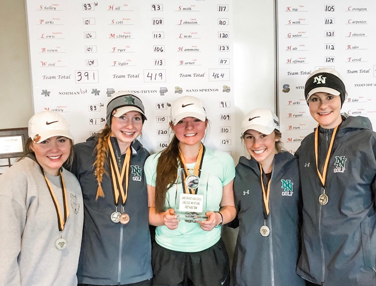 The girls with their medals at the Sand Springs tournament.