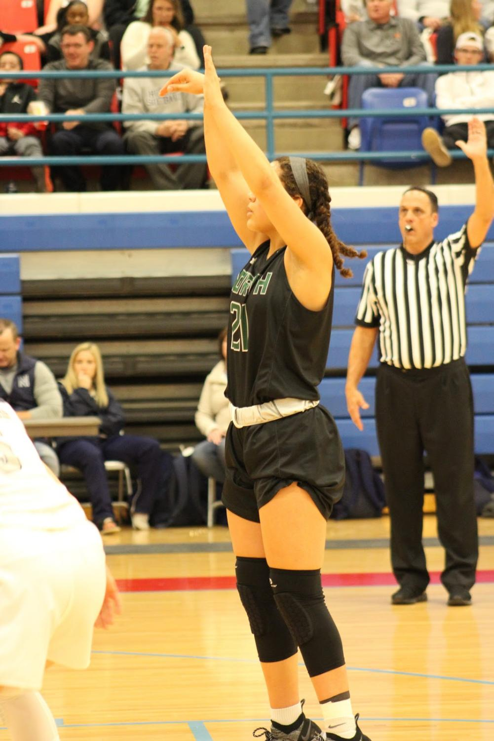 Jacie Evans shooting free throws in the first quarter.