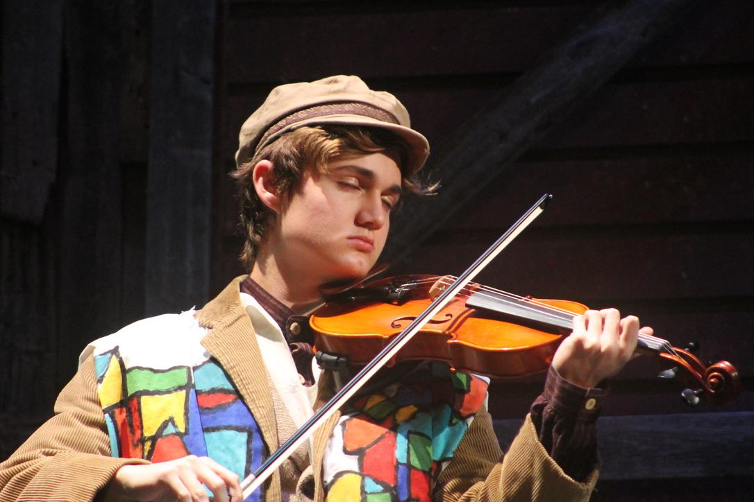 Rodrigo Carmena-Black as the Fiddler in Fiddler on the Roof