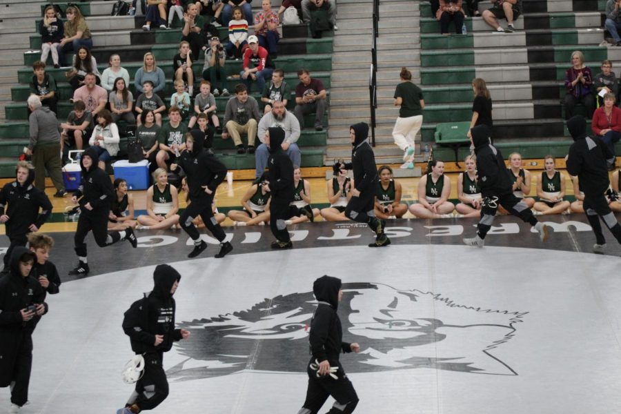 The wrestlers conducting their pre-match warm up.