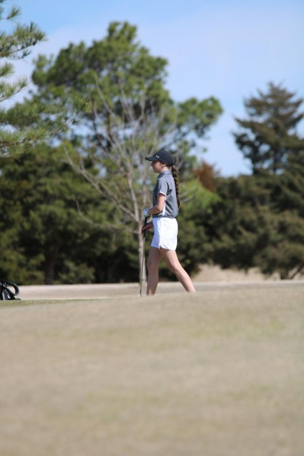 Corban Cook analyzes the green for her put.