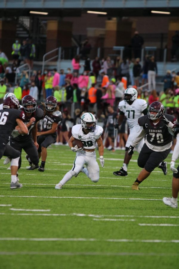 Chapman Mckown rushes up field.
