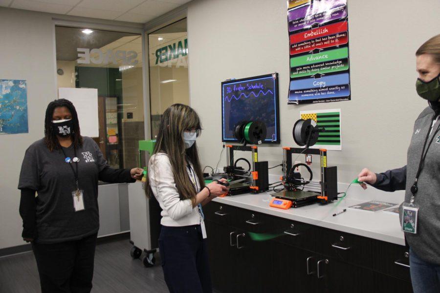 Kaella cutting a ribbion to celebrate the new 3D printer.