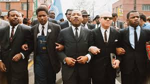 Martin Luther King Jr. leading a march. via The Atlantic