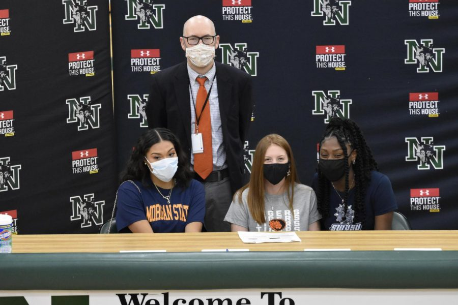 Coach Hamilton and the three girls basketball signees after signing.