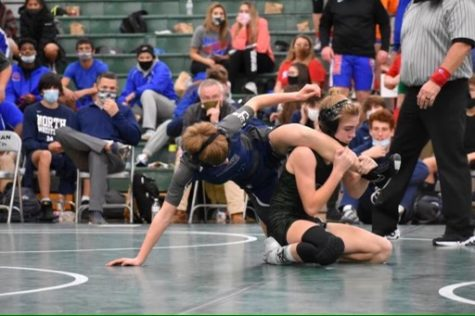 Devin Jansing executes an escape at a home duel before regionals.