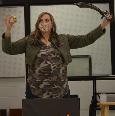 Mrs. Crawford unveiling what the musical will be this year.