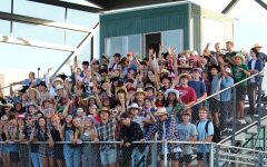 Navigation to Story: Student Section Shows Softball Support
