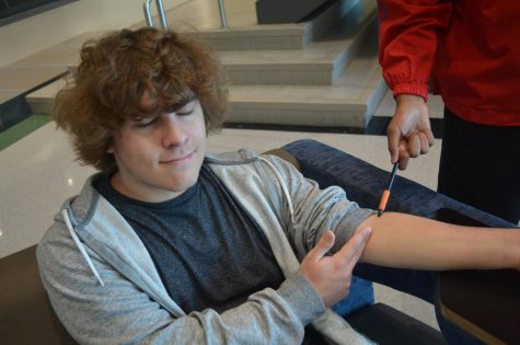 Student giving blood.