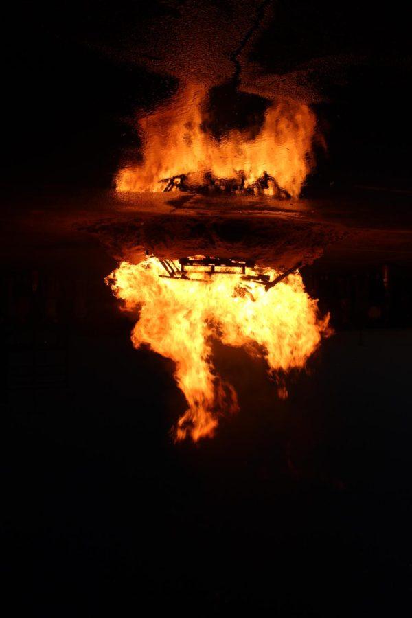 The bonfire burns hot with school spirit.